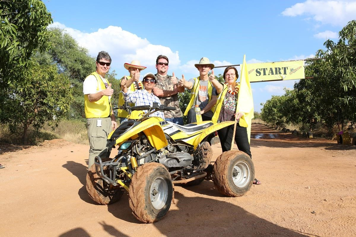 Employees standing by an ATV